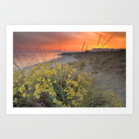 Magical red sunset at the sea Art Print by Guido Montañés