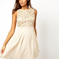 Little Mistress | Little Mistress Babydoll Prom Dress with Cornelli Trim at ASOS