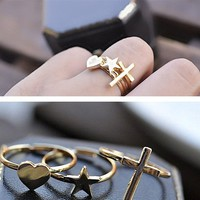 Adjustable 3 Rings Cross, Heart, Star from Purty Products