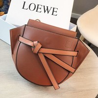 Loewe stylish casual lady solid color knotted saddle bag with diagonal span