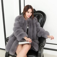 Long fur and long sleeves in the fur coat, fox fur vertical stripes, mink coat.