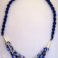 Macrame and beaded necklace with blue silk cord and blue and white seed beads.