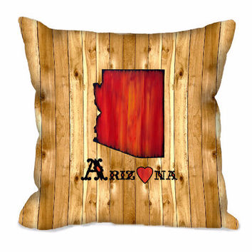Arizona State Throw Pillow in red on wood background