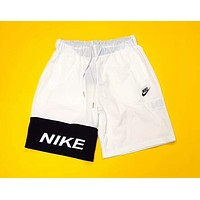NIKE 2018 summer men and women models spoof yin and yang stitching shorts F-AG-CLWM white