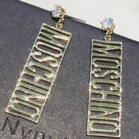 MOSCHINO exaggerated retro nightclub punk girl earrings with exaggerated letters