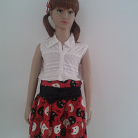 Girl's floaty skirt, printed with cats, with bow that change of color