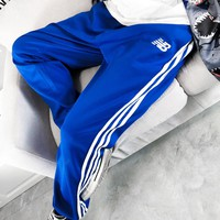 New Balance hot seller of small, embroidered sweatpants with three stripes for men and women