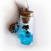 Orca whale in a bottle necklace