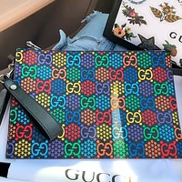Gucci x DISNEY jumping candy series clutch bag wash bag