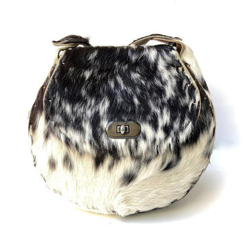 Vintage 1970s black and white cowhide shoulder bag with plaited strap and leather stitched seams