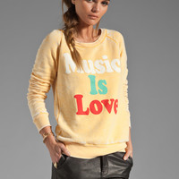 Rebel Yell Music is Love Sweatshirt in Gold from REVOLVEclothing.com