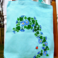Blue and White Flowered Tote Bag With A Ladybug
