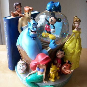 Disney Through the Years Vol. II Musical and Animated Bookend Snowglobe