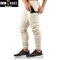 Men's casual GYMS pants fitness male slimming pants men's trousers