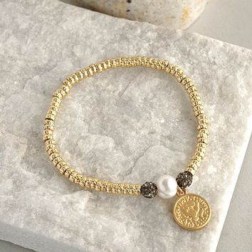 Gold layering bracelet with a coin