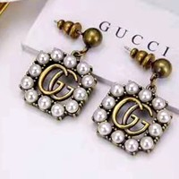 GUCCI pearl letter simple female earrings