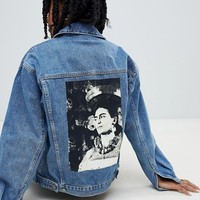 Reclaimed Vintage revived denim jacket with frida back print at asos.com