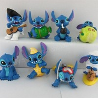 "Retired Disney Lilo and Stitch Play Set Featuring 6 Stitch Figures Ranging From 2"" to 4"" Tall and Includes Scuba Stitch, Elvis Stitch, Safari Camel Riding Stitch, Coconut Sipping Stitch, Apple Eating Stitch, Stitch as a Peanut, Stitch as a Dog, and Stitch"