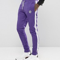 Jaded London Skinny Track Joggers In Purple With Taping at asos.com