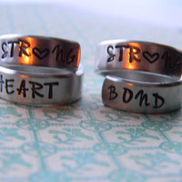 Strong heart strong bond two aluminum swirl rings for sisters , cousins, friends