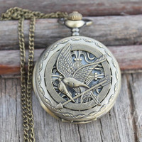 The Hunger Games Logo Mockingjay pendant Victorian by hannahome