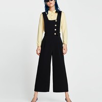 DUNGAREES WITH BUTTONS AND RUFFLE TRIM