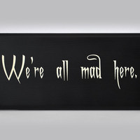 We're all mad here. Alice in Wonderland, Cheshire cat painted sign