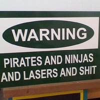 Warning Sign Pirates and Ninjas and Lasers and Shit by Theerin