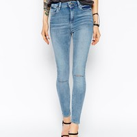 ASOS Ridley Skinny Ankle Grazer Jeans in Penny Midwash Blue with Displaced Ripped Knees