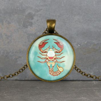 Scorpio zodiac pendant, turquoise background, your choice of silver or bronze and necklace or key ring