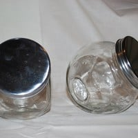 The Oily Essentials 16 oz glass candy jar with silver lid