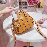 MCM Fashionable and classic stamped hand bill of lading shoulder shell package small package