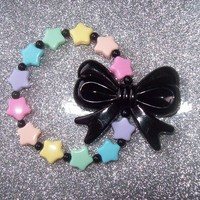 Fairy Witch - Pastel Stars and Black Bow Stretch Bracelet from On Secret Wings
