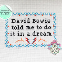 """Finished Unframed """"David Bowie told me to do it in a dream"""" Flight of the Conchords Cross Stitch"""