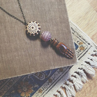 hamsa. an earthy bone protection and fortune amulet.